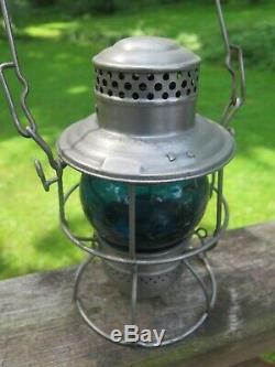 C. M. ST. P & P Railroad Lantern, RSA Signal Green globe (Adams Westlake Co.)