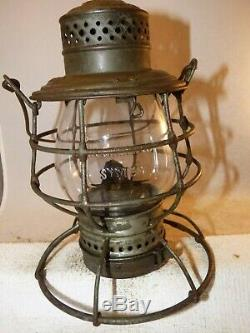 Rock Island System A&W 1895 railroad lantern with clear cast extended base globe
