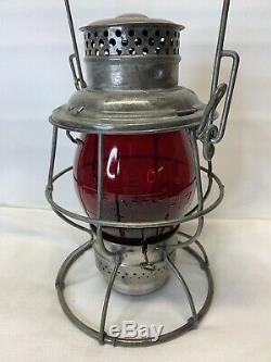 Tall C&NW Ry Adlake Reliable Railroad Lantern with cast Red Globe