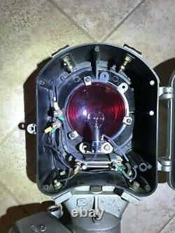 Vintage Railroad signal light by Safetran Systems Corp with red fresnel lens